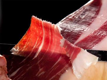 Servicio de Corte de Jamón entero a cuchillo en sobres redondos al vacío de 100 gramos y huesos troceados